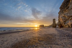 Sunrise at the coast (Mark240590) Tags: sea water sand stack rocks sunrise sun beach