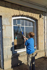 Cleaning the building's windows (FAIRFIELDFAMILY) Tags: jason taylor grant carson chalk drawing chalkboard granite building fountain rock hill sc south carolina winnsboro store front facade cleaning window windows boy young old paint buckets historic architecture arts crafts structure