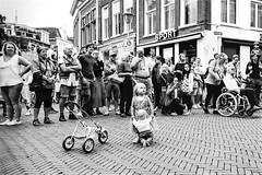 Little girl with doll. (parnas) Tags: straattheater sneek friesland nederland festival zwartwit blackandwhite blackwhite analoog film ilforddelta monochroom streetphotography straat leicam6