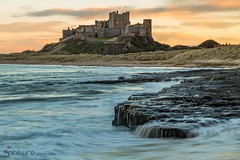 We watched the sunset over the Castle on the hill (Pureo) Tags: beach amateur bamburghcastle canon canon6d clouds castle dusk exposure england flowing flow goldenhour landscape northeast northsea northumberland northeastengland overflow waves rocks seascape glow beauty