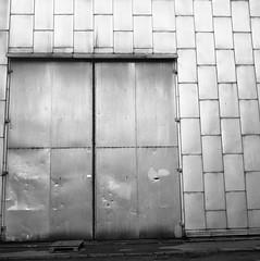 a door (rotabaga) Tags: sverige sweden svartvitt göteborg gothenburg blackandwhite bw bwfp lomo lomography lubitel166 tmax400 twinlens mediumformat mellanformat 120 chalmers