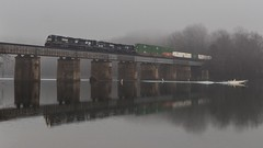 Over and Under (lukeharwell) Tags: freight ge intermodal railway railroad train fog bridge river water fisherman fish boat conrail norfolksouthern electromotivedivision emd sd70