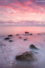 Pink Sunrise. (dasanes77) Tags: canoneos6d canonef1635mmf4lisusm tripod landscape seascape cloudscape clouds pink orange blue dawn sunrise sun rocks longexposure beach ocean shoreline moment morning valencia sagunto ethereal waves formatthitechfilters
