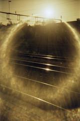 OK Commuter (Magnus Bergström) Tags: lomography redscale xr lomographyredscalexr film 135 35mm luminox luminox356sl analog lomo sweden sverige dalsland åmål åmåls kommun rails railway sun aereola halo circle