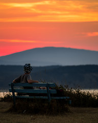 Watching the sunset (christianhadzhiyski) Tags: watching sitting hat red contrast bulgaria blacksea