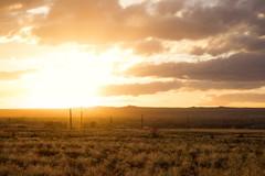 nearing sunset on the mesa (johngpt) Tags: fujifilmxt1 fromapacheplumedrive fujinonxf55200mmf3548rlmois volcanos powerlines sunset places clouds