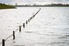 Line of the fence (Richard Gouw) Tags: river water fence high tide dike dutch