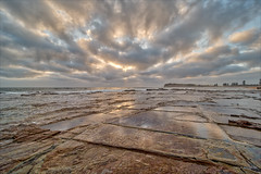 Everything the light touches (JustAddVignette) Tags: australia clouds cloudysunrise collaroy dawn headland landscapes newsouthwales northernbeaches ocean rocks seascape seawater sky sunrise sydney water waves