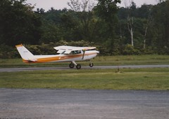 A 1982 CESSNA 152 IN MAY 1986 (richie 59) Tags: ulstercountyny ulstercounty newyorkstate newyork townofulsterny townofulster unitedstates trees spring richie59 america outside airplane oldphotograph olddays oldphoto film 1986 photoscan 35mmfilm 35mm filmcamera filmphotography may311986 may1986 airport photograph photo 1982cessna152 cessna152 cessna airfield aircraft 1980s hudsonvalley midhudsonvalley midhudson runway grass eastkingstonny eastkingston plane smallaircraft smallairplane smallairport singleengineplane flyinglessons