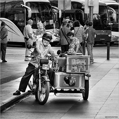 Jolly ice cream seller (John Riper) Tags: johnriper street photography straatfotografie square vierkant bw black white zwartwit mono monochrome singapore candid john riper xt2 fujifilm xf18135 chinatown moped ice cream car happy jolly smiling content helmet motorcycle sidecar bus taxi stop cigarette