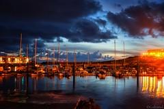 Watching The Boats (galvanol) Tags: canaries sunset atlantic spain bluehour larestinga sailing water island mood ship elhierro galvanol harbour light