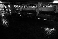 Head towards the light (Jonathan Vowles) Tags: carpark dim dark rain wet catford london