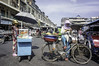 (kuuan) Tags: orusseymarket ផ្សារអូរឫស្សី voigtländerheliarf4515mm manualfocus mf voigtländer15mm aspherical f4515mm superwideheliar apsc nex5n phnompenh cambodia market street seller bicycle fruitstall