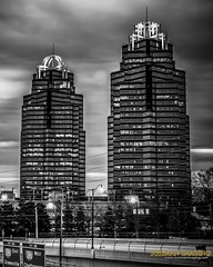 MORNING WITH THE KING AND QUEEN (The Suss-Man (Mike)) Tags: automobile car clouds fultoncounty georgia greenmachine kia kiasoul kingandqueenbuildings longexposure sandysprings sky skyscraper slowshutterspeed sonyilca77m2 sunrise sussmanimaging thesussman urbansunrise bw