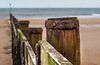Distant sea defences. (CWhatPhotos) Tags: cwhatphotos photograph pics pictures pic picture image images foto fotos photography artistic that which contain digital blyth north east england uk beach seaside coast coastal sea waters sand sandy winter 2018 january sky skies golden sands post posts fences defences depth field dof bokeh distant