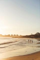 Some more beach waves (ninasclicks) Tags: beach sea silhouettes kids threekids puntadeleste uruguay labarra sand waves cityscape