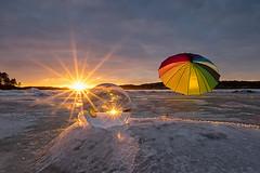 IMGP0224 (jarle.kvam) Tags: sunset umbrella crystalball fun playtime solnedgang norway raetnationalpark tromøy arendal