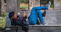 2018 - Mexico City - Chapultepec Park Bench Warmer (Ted's photos - For Me & You) Tags: 2018 cdmx cityofmexico cropped mexico mexicocity nikon nikond750 nikonfx tedmcgrath tedsphotos tedsphotosmexico vignetting male bench earbuds man boy relaxed relaxing sneakers prone shadow denim denimjeans red redrule legs shoes