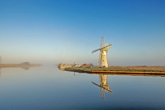 Thurne Mill Norfolk Broads (Geoffrey Tibbenham) Tags: thurne norfolk broads river outdoor openspace countryside reflection foggy frost landscape mill light windmill misty sky blue reedbed quay colour countryfile clear water winter