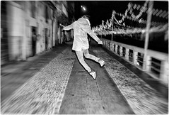 Naviglio by Night (Steve Lundqvist) Tags: fujifilm x100s x100 run running milan italy streetphotography street bw monochrome people sport sporty shop athletic athlete action shot jumping jump pov rear back fly strada naviglio grande navigli canal