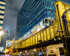 Chicago Night (RW Sinclair) Tags: 19mm art csc dn digital il milc mirrorless snow sony wideangle winter a6000 alpha chicago illinois night sigma train el elevated cta transit building skyscraper nighttime lights yellow street people candid real