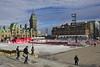Skate rink in front of the Parliament Hill. (Leszek W :)) Tags: leszekwronski rebelt5 people sky buildings canoneosrebelt5 canonrebelt5 canont5 canon t5 skating rink skaterink ottawa parliamenthill sunny winter efs1855mmf3556iii