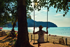 Summer Lazy Days (free3yourmind) Tags: summer lazy day beach water blue sky tree sun sunset swing girl model relax phiphi island thailand