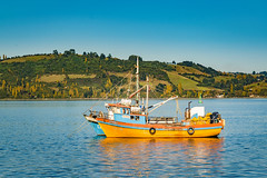 Fishing Boat at Lake, Chiloe, Chile (Daniel Ferreira-Leites) Tags: ifttt 500px sky landscape lake sea water boat river blue coastline ocean old ship pier small town marina fish fishing village one hill america waterfront dock rustic patagonia net latin chile south riverbank jetty motorboat speedboat recreational