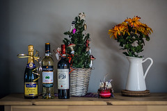 These fine gifts (Melissa Maples) Tags: münchen munich deutschland germany europe nikon d3300 ニコン 尼康 nikkor afs 50mm f18g 50mmf18g winter msomunich holidays christmas tree decorations flowers drink food alcohol bottles wine champagne pasingobermenzing pasing