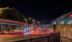 through fare (pbo31) Tags: bayarea sanmateocounty nikon d810 transportation color evening january winter 2018 boury pbo31 motionblur movement night black dark dalycity bart station bus lightstream motion red passage transit muni stop roadway