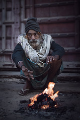 Keeping warm... (Syahrel Azha Hashim) Tags: portrait pushkarlake expression sittingdown 35mm holiday pc9 simple morning indian portraiture holyplace pushkar dof heat nikon headgear street moment shallow getaway handheld streetphotography warmth vacation elder prime cold culture naturallight traditionalclothing colorful warm d300s travel syahrel india people colors light male fire humaninterest detail