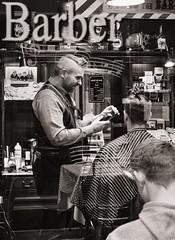 The Barber (raymorgan4) Tags: barber haircut hairdresser trim beard shirt tie fujifilm x100f blackandwhite monochrome street castle arcade quarter cardiff wales shop urban candid unposed shave shaving buzzcut traditional