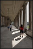 Light and Shadow in the Colonnade (J-o-h-n---E) Tags: ornc greenwich oldroyalnavalcollege photographer couple shadows light converginglines visitors
