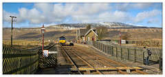 Bagging the shot (david.hayes77) Tags: yorkshire thethreepeaks whernside yorkshiredales sc settleandcarlisle ribblehead snow winter 2018 drs directrailservices shed class66 66425 photographer gaslamps station 0z22 lightengine ribbleheadvirtualquarry railmen snapper pano panorama chapelledale mr midlandrailway 6z22 landscape