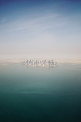 Doha part 2 (tropeone) Tags: sea city cityspace ocean bay water mist doha qatar travel travelogue sky desert
