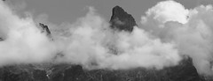 Mountain and Clouds (David K. Marti) Tags: mountain mountainscape mountainside peak top rock formation massive stone sky clouds weather travel travelling traveling alps alpine europe european arete landscape scenic scenery nature natural country countryside light shadow silhouette widescreen panorama panoramic outdoors outdoor outside day daylight sun sunlight grey gray black white blackandwhite blackwhite bw mono monotone monochrome petitmuveran