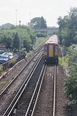 EMU approaching Poole Level Crossing, June 2004 (Ian D Nolan) Tags: poolestation railway 35mm epsonperfectionv750scanner