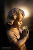 Prayer (Jon Bowles) Tags: cherub prayer light halo figurine statue girl graveyard