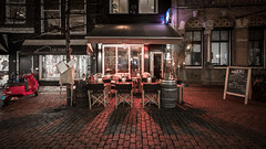 Metzo (McQuaide Photography) Tags: haarlem noordholland northholland netherlands nederland holland dutch europe sony a7riii ilce7rm3 7rm3 alpha mirrorless 1635mm sonyzeiss zeiss variotessar fullframe mcquaidephotography lightroom adobe photoshop tripod manfrotto night nacht nightphotography stad city urban lowlight architecture outdoor outside illuminated street straat warmoesstraat window wideangle wideanglelens groothoek building longexposure oldstreet old oud character traditional authentic streetlight atmosphere sfeer winter nopeople cobblestone cobbles metzo restaurant shadow light licht