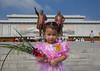 North Korean girl with flowers paying respect to the two statues of the Dear Leaders in Grand monument of Mansu hill, Pyongan Province, Pyongyang, North Korea (Eric Lafforgue) Tags: architecture asia asianethnicity child children communism cultofpersonality dailylife day dictator dictatorship dprk father girl groupofpeople headandshoulders horizontal ideology img7130 kimilsung kimjongil lookingatcamera mansuhill mansudaehill monument nationallandmark northkorea northkorean onegirlonly oneperson outdoors patriotism portrait propaganda pyongyang statue traveldestinations pyonganprovince 北朝鮮 북한 朝鮮民主主義人民共和国 조선 coreadelnorte coréedunord coréiadonorte coreiadonorte 조선민주주의인민공화국 เกาหลีเหนือ קוריאההצפונית koreapółnocna koreautara kuzeykore nordkorea північнакорея севернакореја севернакорея severníkorea βόρειακορέα