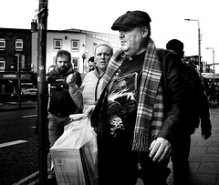 Tartan (Owen J Fitzpatrick) Tags: ojf people photography nikon fitzpatrick owen pretty pavement chasing d3100 ireland editorial use only ojfitzpatrick eire dublin republic city tamron candid joe candidphotography candidphoto unposed natural attractive beauty beautiful woman female lady j face hair along bw black white mono blackwhite blackandwhite monochrome blancoynegro pretoebranco photoshoot street 2017 centre scarf cap hat amiens hand signal building glasses spectacles shirt illustrated bag plastic tartan chopped retail outlet pole blonde blanconegro