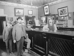 Toonie Tuesdays ... (Mr. Happy Face - Peace :)) Tags: yyc happyhour vintage pub art2018 strangers candid 1880s 7dwf photo publicdomain unknown men bartender