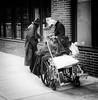 The Wheelchair (daveson47) Tags: wheelchair people candid contrast mono monochrome bw blackandwhite street streetphoto urban city gritty homeless olympus olympuspenf penf minneapolis