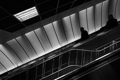 \ the only way is down \ (Özgür Gürgey) Tags: 2018 20mm bw d750 levent nikon voigtländer architecture diagonal escalator geometry grainy lines people silhouettes station street subway istanbul