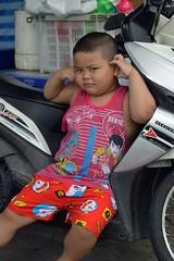 cranky looking chubby boy resting against motorcycle (the foreign photographer - ฝรั่งถ่) Tags: jul192015nikon chubby boy resting against motorcycle khlong lat phrao portraits bangkhen bangkok thailand nikon