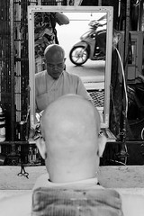 Barber (gergelytakacs) Tags: asia fareast hanoi hànội viet vietnam vietnamese việtnam bw bald baldheaded barber bare beard blackandwhite bystander calle candid city documentary flâneur glasses guy hair haircutter hairdresser hairless head man mirror monochrome motorbike motorcycle people photo photography portrait public reading reflected reflection rue scissors shave shaven shaver skinhead smooth space strada stranger strasenfotografie street streetphotographer streetphotography streetphotgrapher streetphotgraphy streetphoto streets streetscape ulica unposed urban urbanphoto urbanphotographer urbanphotography utcafotó улица רחוב