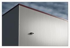 single light (Rick Olsen) Tags: building wall minimal light clouds