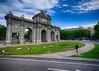 Triumphal arch Puerta de Alcala in Madrid, Spain. (` Toshio ') Tags: toshio triumph arch roundabout triumphalarch puertadealcala plazadelaindependencia madrid spain fujixe2 xe2 spanish europe european europeanunion person architecture clouds city