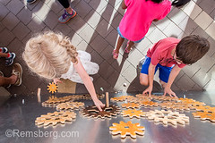 Young girl and boy play with wooden gears on board,  Silver Spring, Maryland (Remsberg Photos) Tags: children kid learning gears puzzle wooden toy kids playing brainteaser childhood creativity concentration complexity together younggirl youngboy silverspring maryland usa