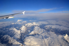 Crossing the Alps (Thomas Roland) Tags: schweiz switzerland alps mountains snow winter sky plane view udsigt landscape landskab rome rom roma italia italy italien europe europa travel rejse holiday city by stadt roman tourist tourism destination visitors